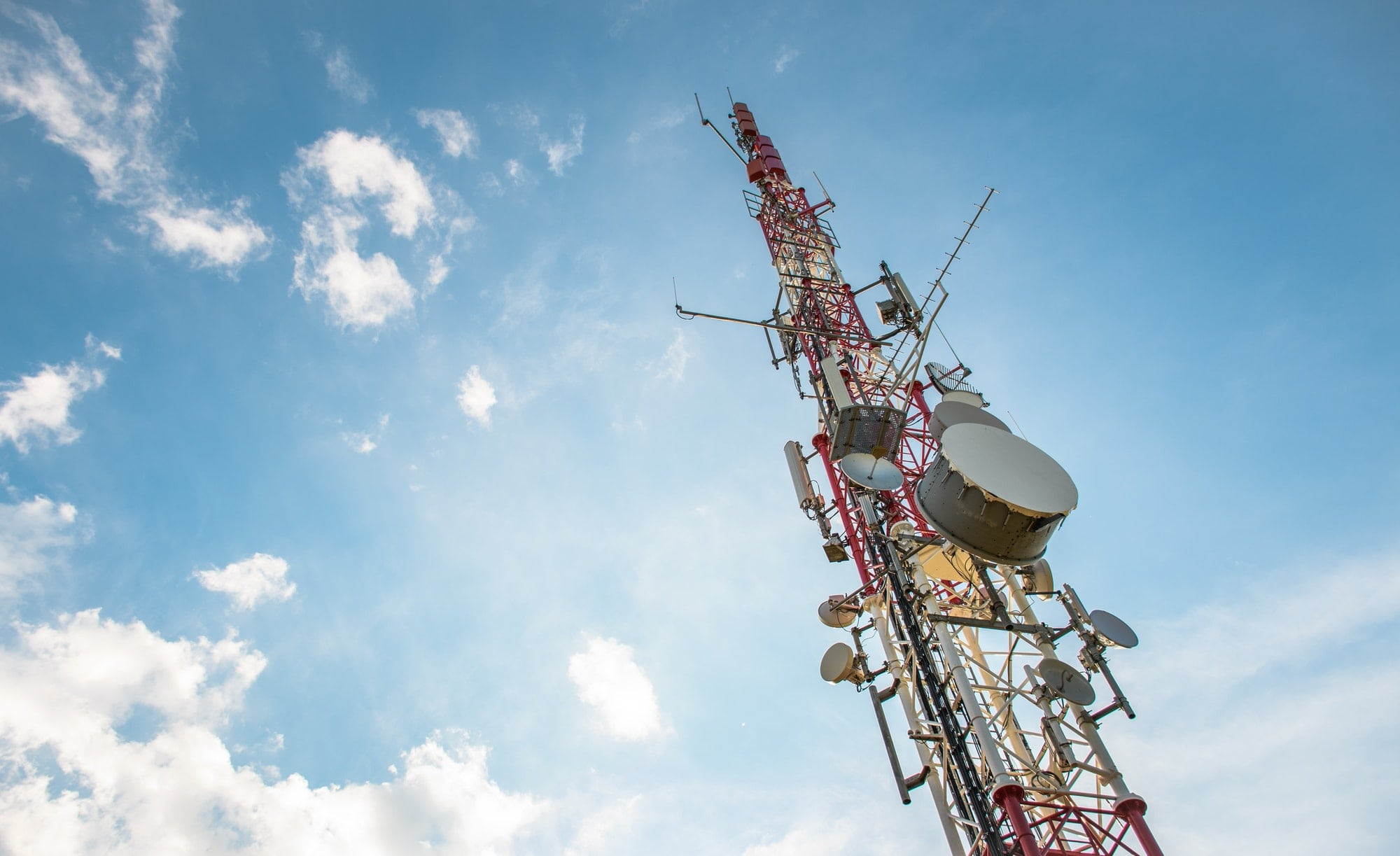 Antenna tower against a blue sky, 5g, broadcasting, wireless, radiowave, network.